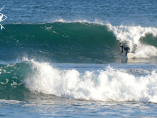 surfer bottom turn, Mag Bay mexico