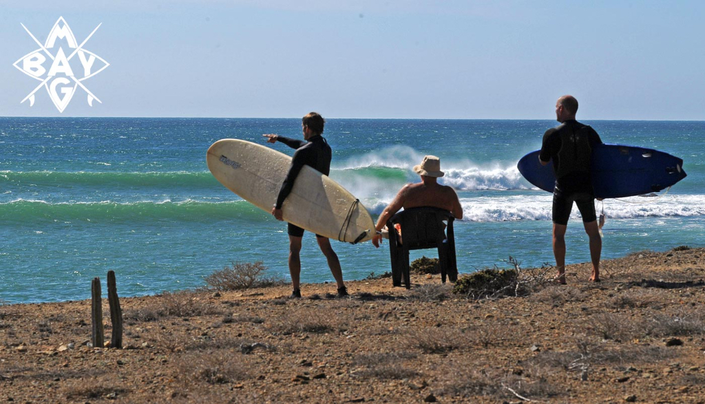 Surfers study waves, Mag Bay Mexico