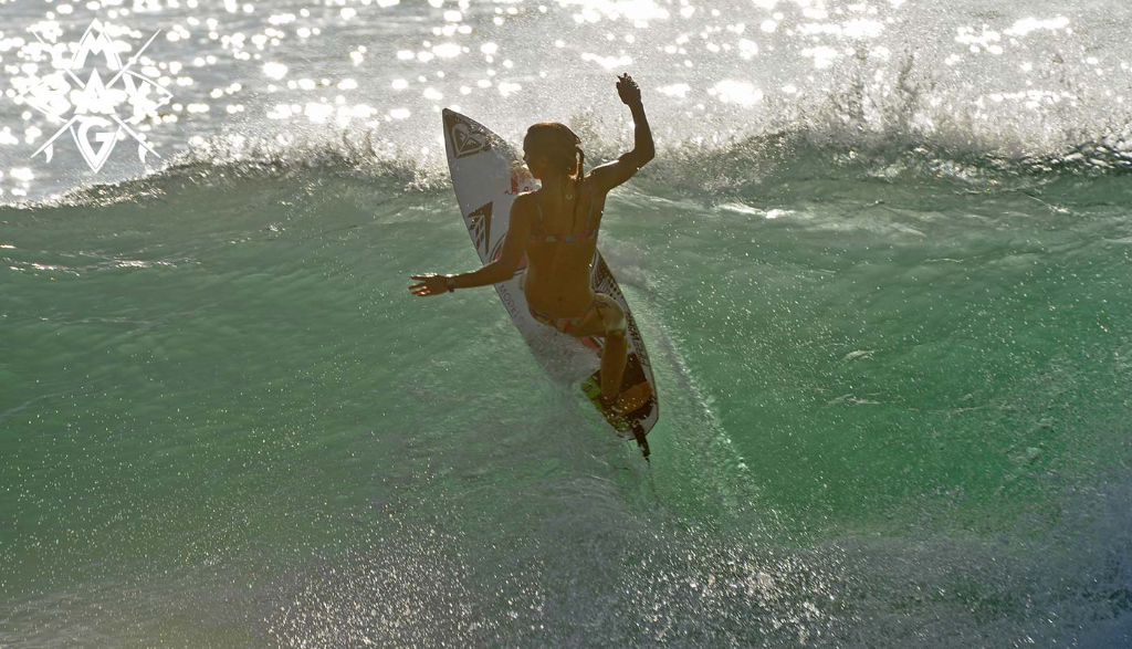girl surfer off the lip, Mag Bay Mexico
