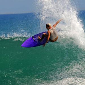 Girl Surfer big off the lip, Mag Bay Mexico