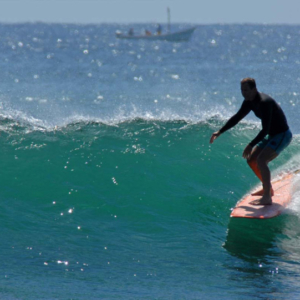 Longboard with boat in background, Mag Bay Mexico