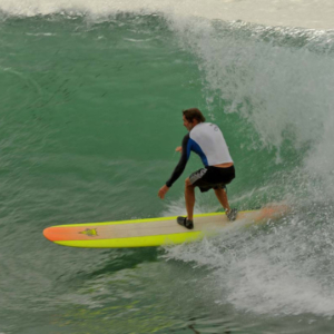 Longboarder on a big wave, Mag Bay Mexico