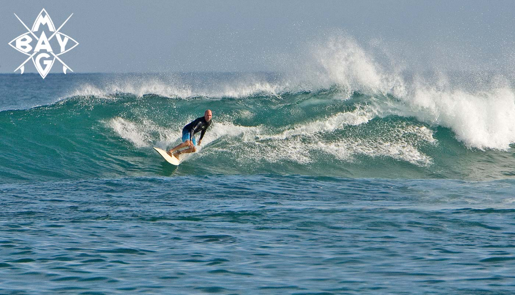 Surfer cut back at Cuevas, Mag Bay mexico