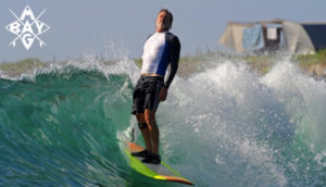 Surfer standing tall, Mag Bay Mexico